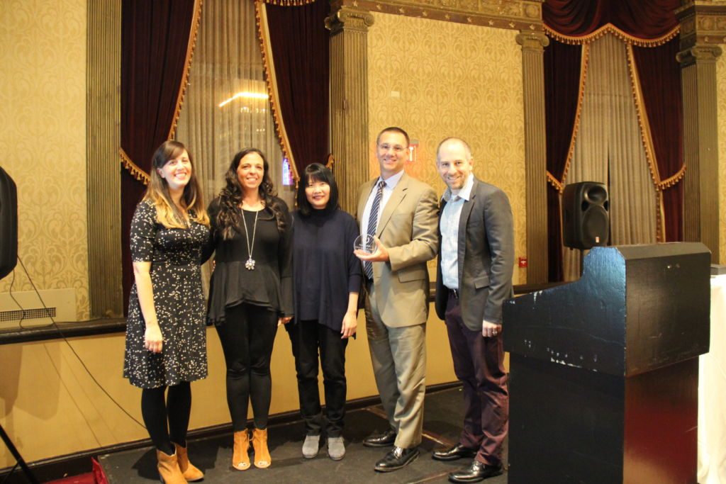 Woonsocket's Heather Neil, Jenny Chan Kim Ramos & Michele Humbyrd are awarded the first ever District Leadership Award at the Cohort 2 Induction Ceremony, November 2017